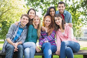 Group portrait of young college students in the park
